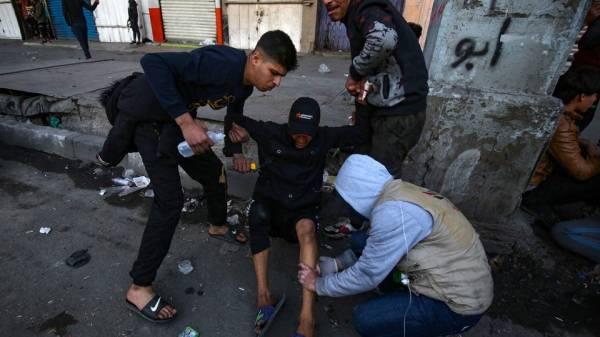 تجدد الاشتباكات وسط بغداد.. ومسيرات في النجف وكربلاء